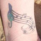 Music Notes on a Staff Tattoo