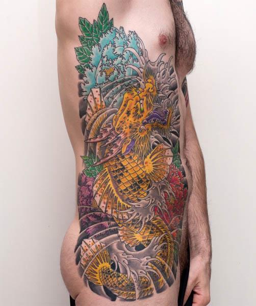 http://inkarttattoos.com/tattoo-designs/color-tattoos/koi-dragon-tattoo/