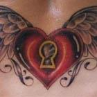 Locked Heart With Wings Lower Back Tattoo