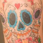 Three Sugar Skull Tattoos with Rose and Dagger