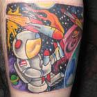 Astronaut Playing With Rockets Tattoo