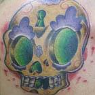 Yellow Purple Green Sugar Skull Tattoo